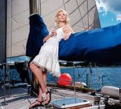 Stylish woman on a yacht Royalty Free Stock Photos