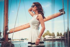 Stylish woman on a yacht Royalty Free Stock Photography