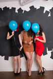 Stylish Women Behind Balloons Stock Images