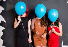 Stylish Women Behind Balloons Royalty Free Stock Photography