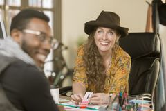 Stylish Woman with Colleague or Client. Stylish women in her office with colleague or client Royalty Free Stock Photo