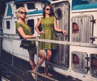 Stylish women on old boat Stock Images