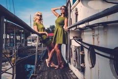 Stylish women on old boat Stock Photography