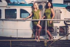 Stylish women on old boat Stock Photos