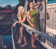 Stylish women on old boat Royalty Free Stock Photos