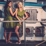 Stylish women on old boat Stock Photo