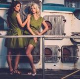 Stylish women on old boat Stock Photo