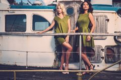 Stylish women on old boat Royalty Free Stock Photography