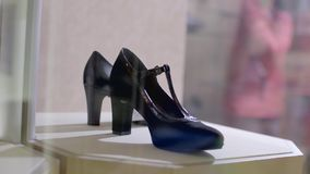 Stylish women`s heels. Stylish black leather women`s heels on the shelf in the shop. Pavilion of the store with fashionable female shoes. Leather autumn and stock video
