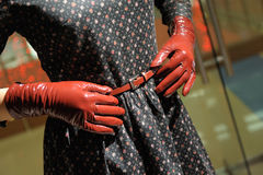 Stylish women& x27;s red gloves and belt. Stylish women& x27;s red gloves and belt Stock Photos