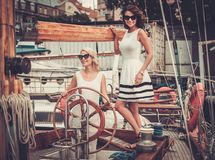 Stylish women on a yacht Stock Image