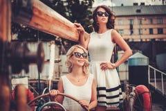 Stylish women on a yacht royalty free stock photography