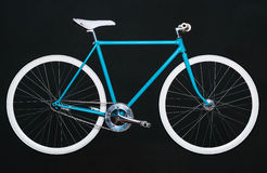 Stylish womens blue bicycle isolated on black Stock Images