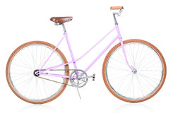 Stylish womens pink bicycle isolated on white Royalty Free Stock Photography
