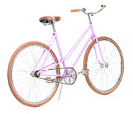 Stylish womens pink bicycle isolated on white Royalty Free Stock Photos