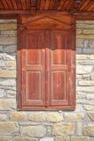 Stylish wooden window on stone wall Stock Photography