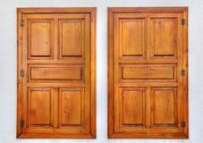 Stylish wooden windows on stone wall Stock Photos