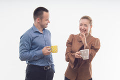 Stylish workmates laughing while having coffee Stock Photos