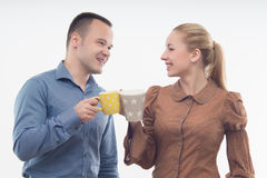 Stylish workmates laughing while having coffee Stock Images