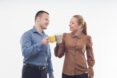 Stylish workmates laughing while having coffee Royalty Free Stock Photography