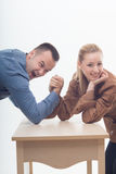 Stylish workmates laughing while playing arm Royalty Free Stock Images