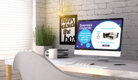 Stylish workplace with computer with insurance comparator on the Royalty Free Stock Photography