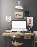 Stylish workplace mockup. Stylish workspace with computer and posters on home or studio Royalty Free Stock Photo