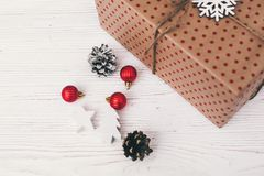 Stylish wrapped gift box top view, with red ornaments tree and c. One. craft present. seasonal greetings, happy holidays. merry christmas and happy new year Stock Photos