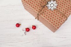 Stylish wrapped gift box top view, with red ornaments tree and c. One. craft present. seasonal greetings, happy holidays. merry christmas and happy new year Royalty Free Stock Photo