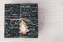 Stylish wrapped gift box top view, with wooden ornament tree. mo. Dern present flat lay. seasonal greetings, happy holidays. merry christmas and happy new year Stock Photography