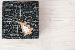 Stylish wrapped gift box top view, with wooden ornament tree. mo. Dern present flat lay. seasonal greetings, happy holidays. merry christmas and happy new year Royalty Free Stock Photography