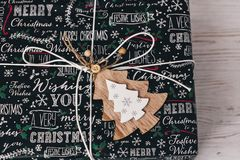 Stylish wrapped gift box top view, with wooden ornament tree. mo. Dern present. seasonal greetings, happy holidays. merry christmas and happy new year concept Royalty Free Stock Photo
