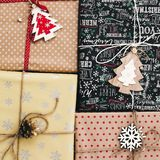 Stylish wrapped gift boxes top view, with ornaments tree pine co. Nes and twine. merry christmas and happy new year concept. image flat lay. seasonal greetings Stock Photography