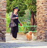 Stylish 90 years old woman walking around city. Granny female outdoors Royalty Free Stock Photo