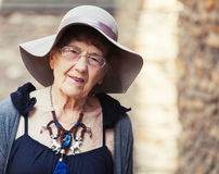 Stylish 90 years old woman walking around city. Granny female outdoors Royalty Free Stock Photos