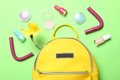 Stylish yellow backpack  and  different women`s cosmetics royalty free stock images