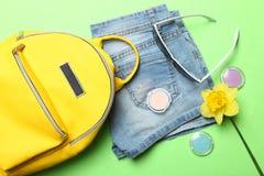 Stylish yellow backpack, shorts, sunglasses royalty free stock photography