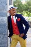 Stylish young african american man in suit and hat Stock Photography
