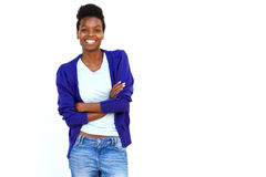 Stylish young african female model with arms crossed. Portrait of stylish young african female model standing with arms crossed against white background Stock Photos