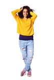 Stylish young african female model. Full length portrait of stylish young african female model posing with her hands in hair over white background Stock Image