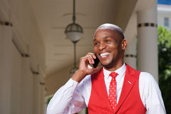 Stylish young african man talking on mobile phone Stock Image