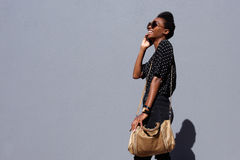 Stylish young afro girl talking on mobile phone Stock Photography