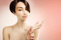 Stylish young asian model with surgery marks on her face Royalty Free Stock Images