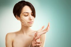 Stylish young asian model with surgery marks on her face Royalty Free Stock Image