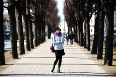 Stylish, young and beautiful girl with color hair poses on streets of St. Petersburg Royalty Free Stock Photos