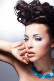 Stylish young beauty looking. Glamor and luxury Royalty Free Stock Photo