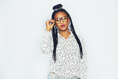Stylish young black woman standing and touching goggles Stock Image