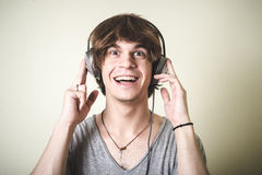 Stylish young blonde hipster man listening to music Stock Image