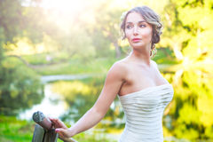 Stylish Young Bride Outdoors at Green Nature Background. Toned Photo. Stylish Young Bride Outdoors Portrait at Green Nature Background. Modern Wedding Hairstyle Royalty Free Stock Photo