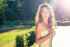 Stylish Young Bride Outdoors at Nature Background. Royalty Free Stock Photo